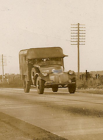 Ex-Army Ambulance, the Brigade's first vehicle seen on the Pacific Highway, Berowra.