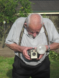 Neil Davis with his Brownie Box Camera and Flash     Photo: Merle Davis