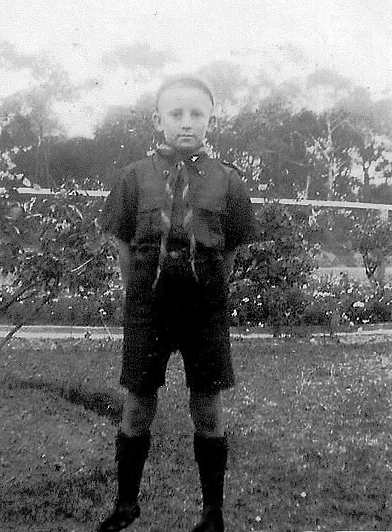 Neil Davis in his cub's uniform, 1940